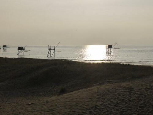 La plage et ses carrelets