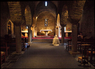 The lone prayer in St Martin du Canigou, a photo from Languedoc-Roussillon,  South   TrekEarth
