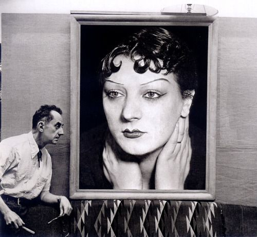 Man Ray in front of a portrait of Kiki de Montparnasse taken in the 1930s, Paris, 1954 -by Michel Sima: