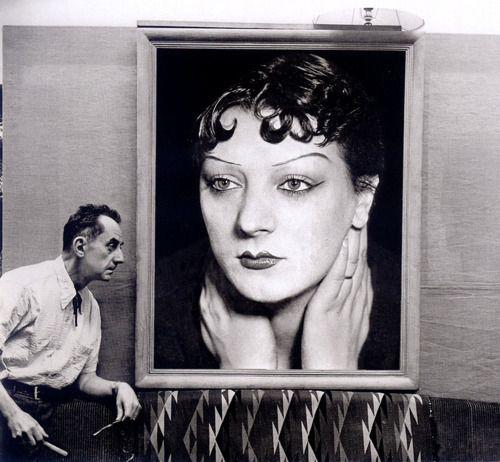 Man Ray in front of a portrait of Kiki de Montparnasse taken in the 1930s, Paris, 1954 -by Michel Sima: