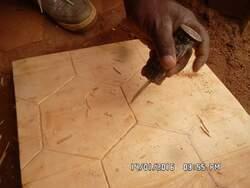 Pose des tomettes en terre cuite