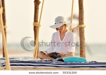 stock-photo-young-woman-outdoor-in-summer-55331200