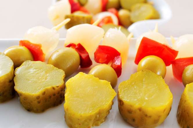 One of the easiest tapas to put together, banderillas are pickled items like olives, cucumbers, garlic, red pepper, and other vegetables served on skewers.
