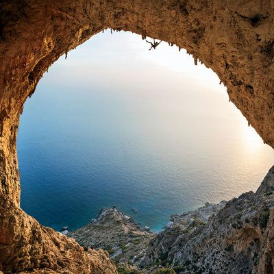 Greetings from Telendos, Greece! The vaulted arc of this tiny island's Crystal Cave frames the Aegean and lures climbers to its dizzying apogee.