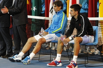 868538_djokovic-of-serbia-and-nadal-of-spain-sit-as-they-wait-for-trophy-presentation-after-their-fi