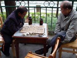 Chine: Chengdu, joueurs de majong sur les quais