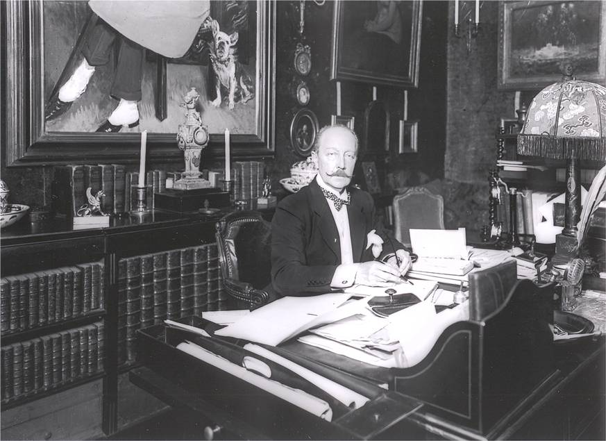 b&w photo of Boni at his desk ca.1920's