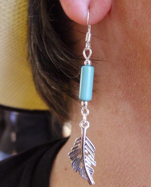 Boucles d'oreilles country plumes avec sa perle turquoise