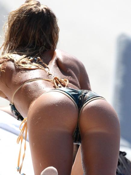 sexy women in bikinis bent over