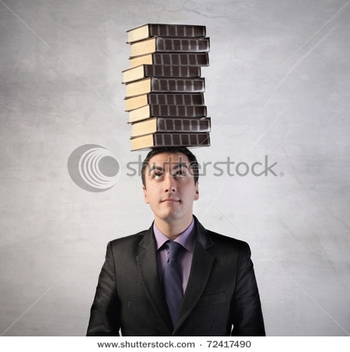 stock-photo-man-with-stack-of-books-on-his-head-72417490