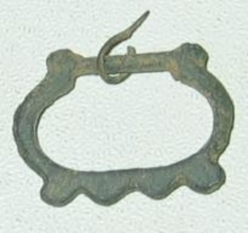 petite boucle en bronze revers