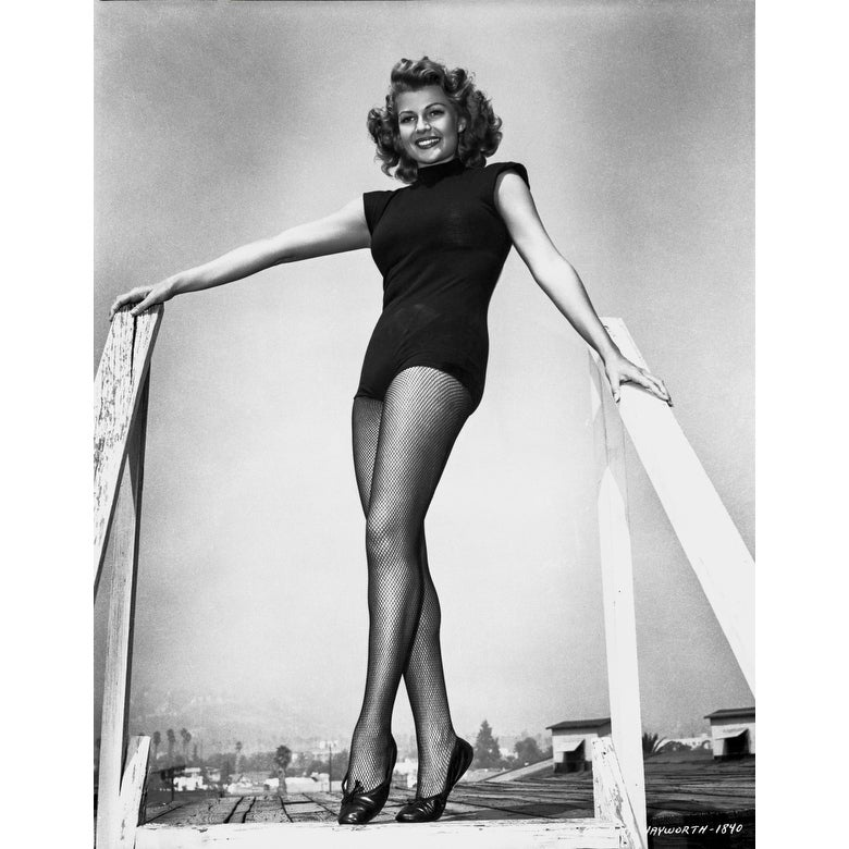 https://ak1.ostkcdn.com/images/products/is/images/direct/8d3f251bbdc91afaa250ec2ae0bb6ff785db5f58/Rita-Hayworth-wearing-a-Sexy-Black-Dress-in-a-smiling-Posed-Photo-Print.jpg