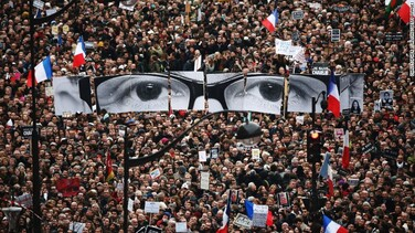 "<strong>January 11:</strong> The eyes of Charlie Hebdo editor Stephane Charbonnier appear at <a href=""http://www.cnn.com/2015/01/11/world/gallery/paris-unity-rally/index.html"" target=""_blank"">an anti-terrorism rally in Paris.</a> More than a million people took part in the demonstration, a gesture of unity just days after Charbonnier and 16 others were slaughtered."