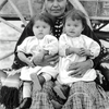 A Diné (Navajo) woman with twins. Photo by Mullarky Photo, taken between 1914-1930