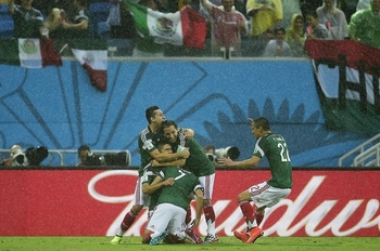 653274-mexican-players-celebrate-after-mexico-s-forward-oribe-peralta-scored-during-a-group-a-football-matc