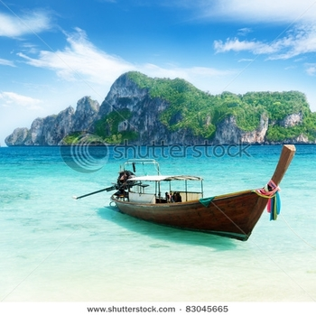 stock-photo-boat-on-phi-phi-island-thailand-83045665