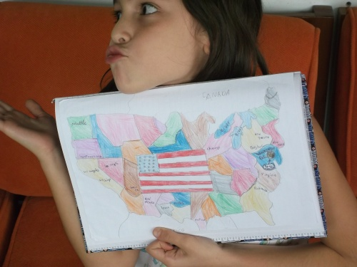 Students present their American flags for their poetry books!