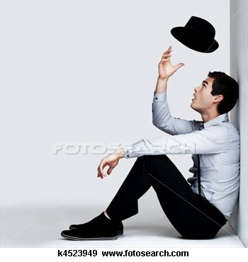 young-man-sitting_~k4523949