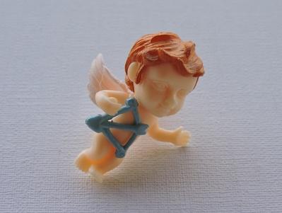 Cupidon flèche rouge ou bleue