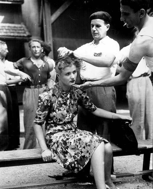 A French woman has her head shaved as punishment for having had personal relations with the Germans. Montelimar area, August 29, 1944.: