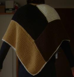 Dos poncho tricotin