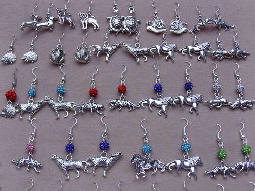 Boucles d'oreilles fantaisies lions, guépards,loups et sangliers