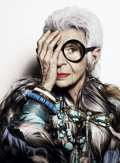 "Iris Apfel is a ""American businesswoman, interior designer, and fashion icon"" ... who works for the occult elite."