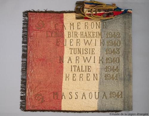 * Le premier Drapeau de la 13ème Demi-Brigade de la Légion Etrangère (DBLE).