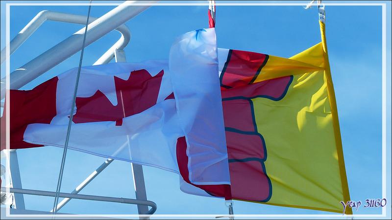 Drapeau du Nunavut mêlé à celui du Canada