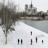 394483_les-quais-de-seine-a-paris-recouverts-de-neige-le-5-fevrier-2012-lors-de-la-vague-de-froid
