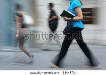 stock-photo-female-student-walking-holding-books-and-bag-83448724