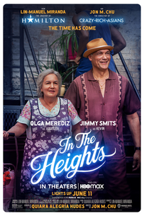 In The Heights - Olga Merediz and Jimmy Smits on steps looking and smiling