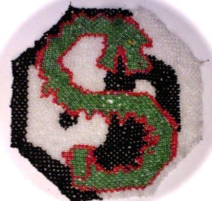 le napperon dragon de 15cm environ