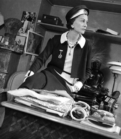 Coco Chanel on her desk wearing her own design, photo by François Kollar, 1938: