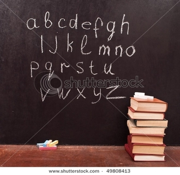 stock-photo--alphabet-on-a-chalkboard-with-books-49808413