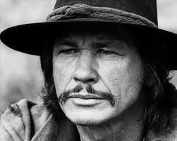 Votre Bronson, avec ou sans moustache ?