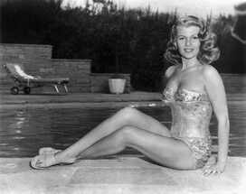 https://imgix.ranker.com/user_node_img/50014/1000274962/original/rita-hayworth-shimmery-swimwear-photo-u1?w=650&q=50&fm=pjpg&fit=crop&crop=faces