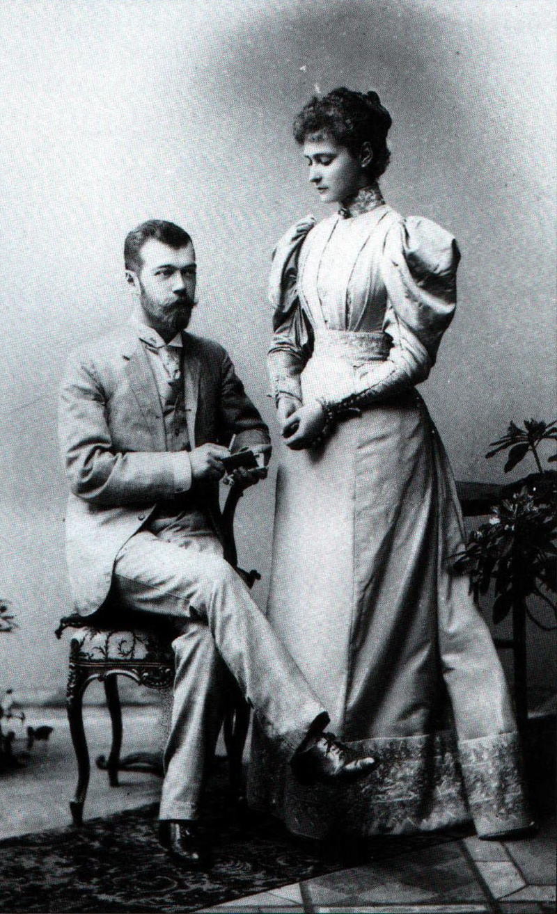 themauveroom:  This is a photo of Nicholas and Alix of Hesse upon their engagement in 1894. The couple originally met in 1884 for Alix's sister Ella's wedding to Nicholas' Uncle Sergei. Nicholas was sixteen and Alix was twelve.  They met again in 1889, when Nicholas was twenty-one and Alix was seventeen. At that time he decided that he wanted to marry her. He asked for her hand several times, only to be met with rejection because Alix felt that it was sinful to change her religion from Lutheranism to Russian Orthodoxy. The day after the wedding of Alix's brother Ernie to Victoria Melita (Ducky) of Coburg, she finally consented.  Source: The Romanovs: Love, Power, and Tragedy