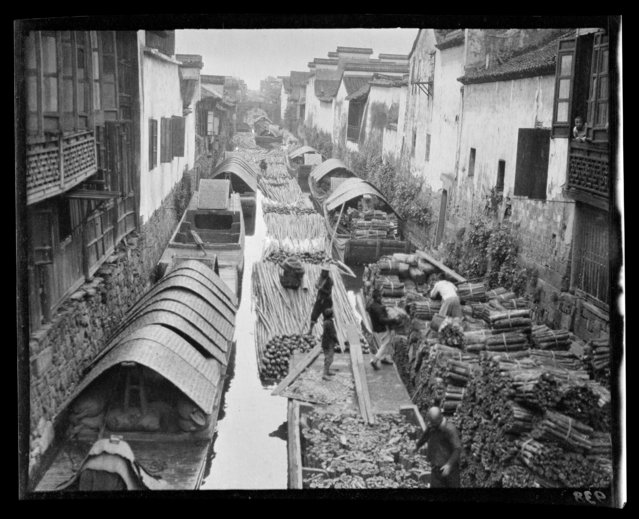 Wood Market and Canal. China, Hangzhou, 1917-1919. (Photo by Sidney David Gamble)