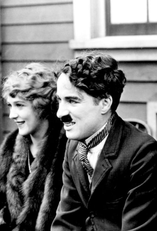 Mary Pickford & Charlie Chaplin photographed at the announcement of the formation of the United Artists corporation,1919: