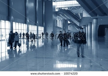 stock-photo-moving-people-in-hall-of-modern-building-10074220