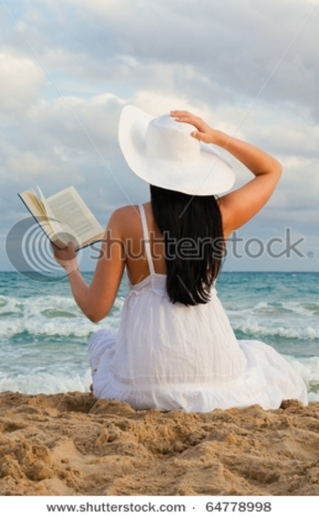 stock-photo-travel-woman-reads-book-on-the-beach-64778998
