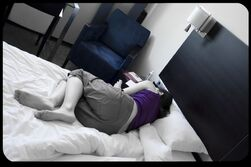 depressed woman on a bed