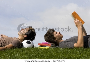 stock-photo-two-young-students-lying-on-the-grass-53701675