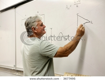 stock-photo-a-middle-aged-man-going-back-to-school-or-a-teacher-writing-on-the-board-3677495