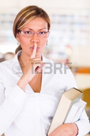 16586955-female-student-asking-to-keep-quiet-at-the-library