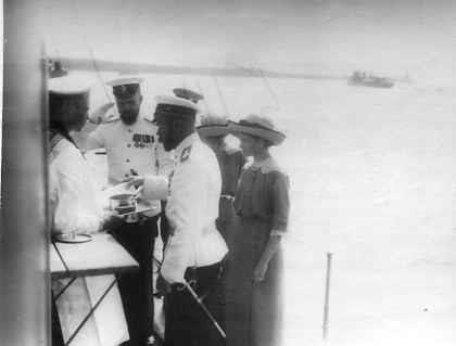 Nicholas II tasting the soldiers' food aboard the Standart, accompanied by Grand Duchesses Olga and Tatiana: 1913.