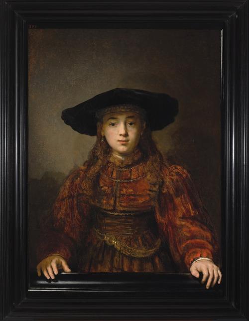 Fille au chapeau dans un cadre par Rembrandt