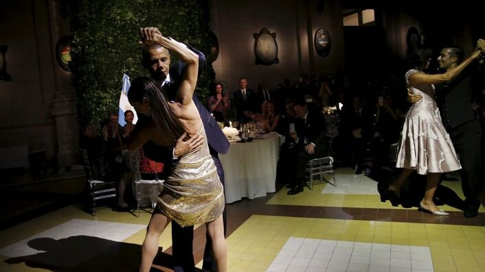 U.S. President Barack Obama and his wife Michelle dance tango during a state dinner hosted by Argentina's President Mauricio Macri at the Centro Cultural Kirchner as part of President Obama's two-day visit to Argentina, in Buenos Aires