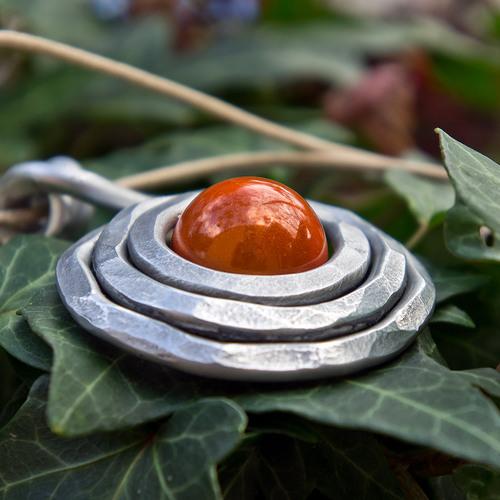 pendentif en aluminium et perle magique